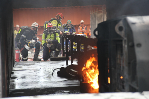 Mines rescue personnel fighting fire